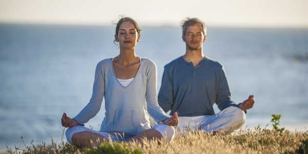 Meditating couple following buddhist dating rules