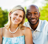 Happy interracial couple smiling outside
