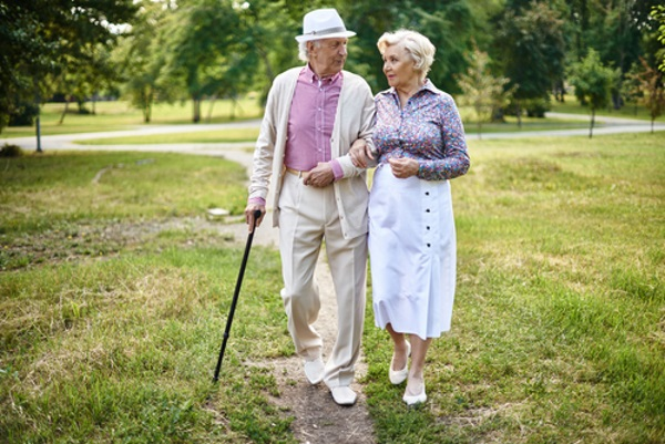 Senior-couple-walking-in-park