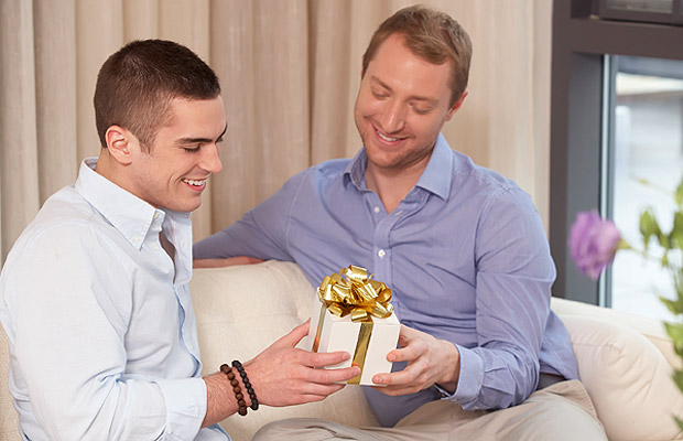 Man holding roses and gift for gay online date