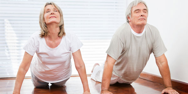 Single seniors in Texas at yoga