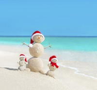 Snowmen on beach