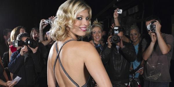 Celebrity posing for cameras