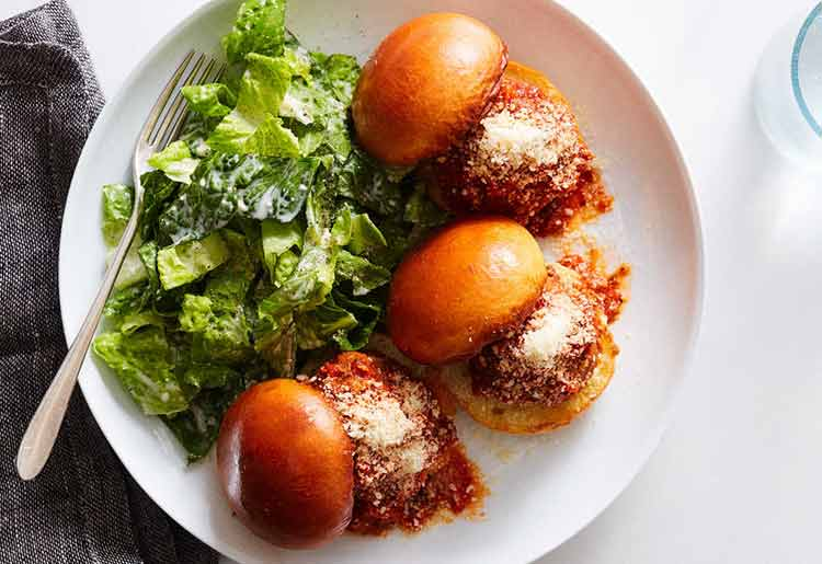 Saucy meatball sliders with classic caesar salad