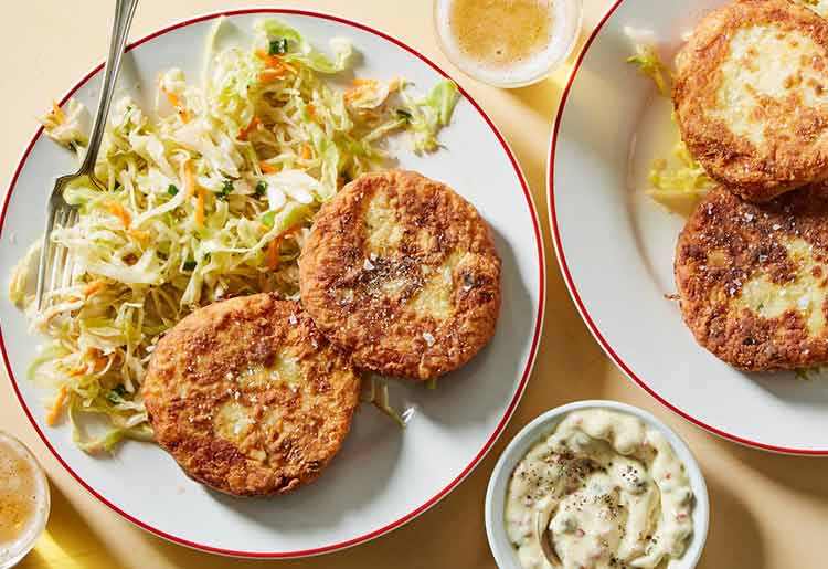 Potato-fish cakes with slaw and caper aioli
