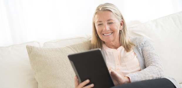 Senior on Tablet Device