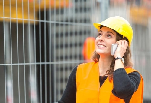 woman on voip phone at construction site