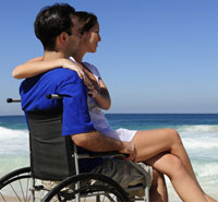 Handicapped dating couple at the beach