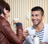 Singles having coffee while speed dating
