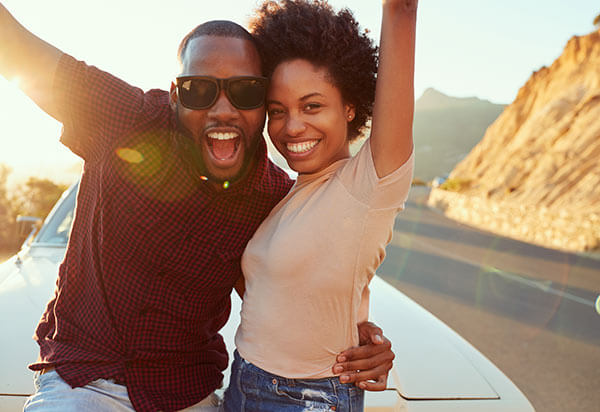 Happy couple outdoors - best black dating sites