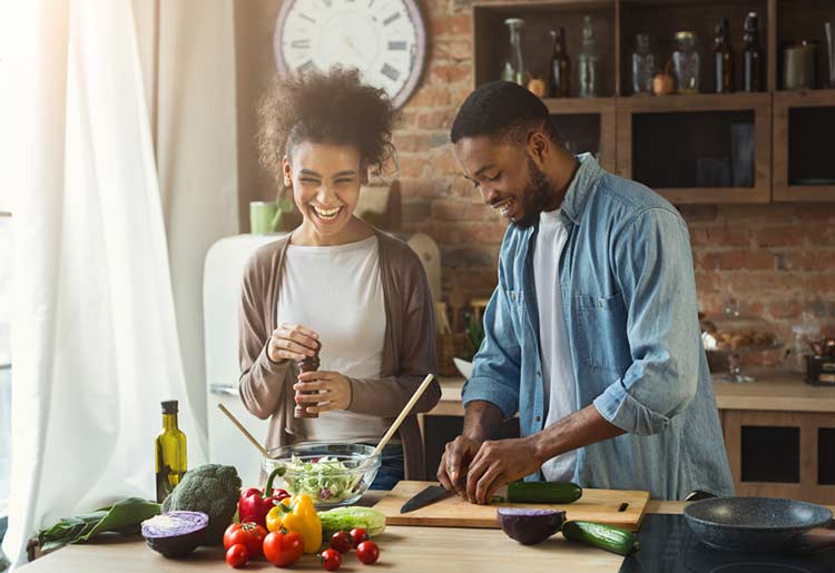 Happy home cooking couple